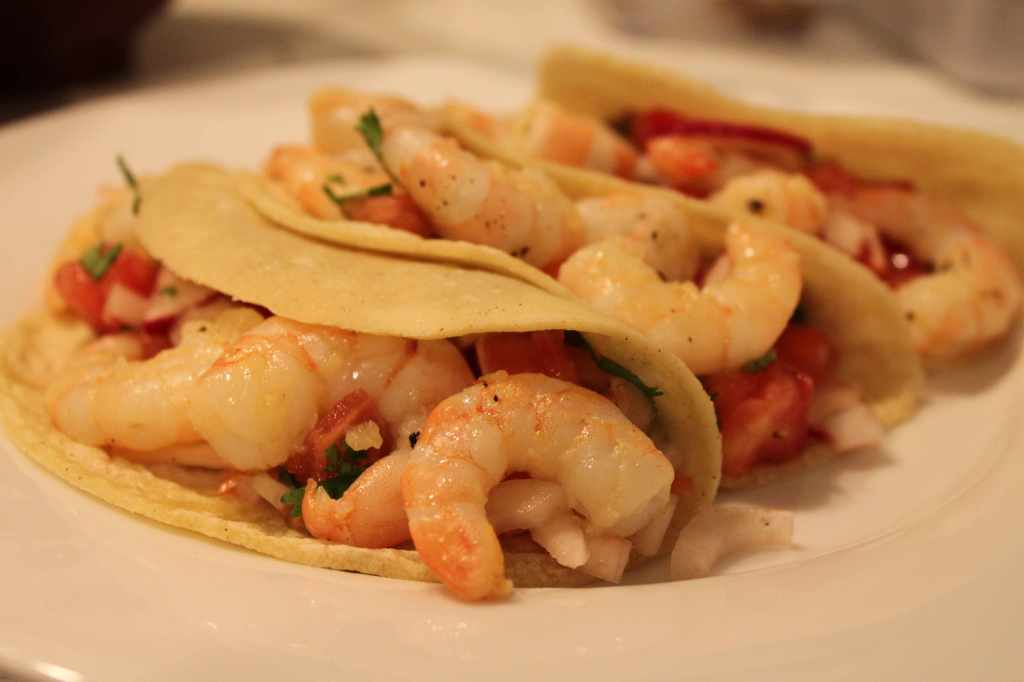 shrimp tacos with tomato, radish, and habañero