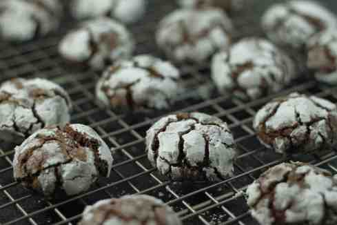 chocolate hazelnut crinkles on cooling racks