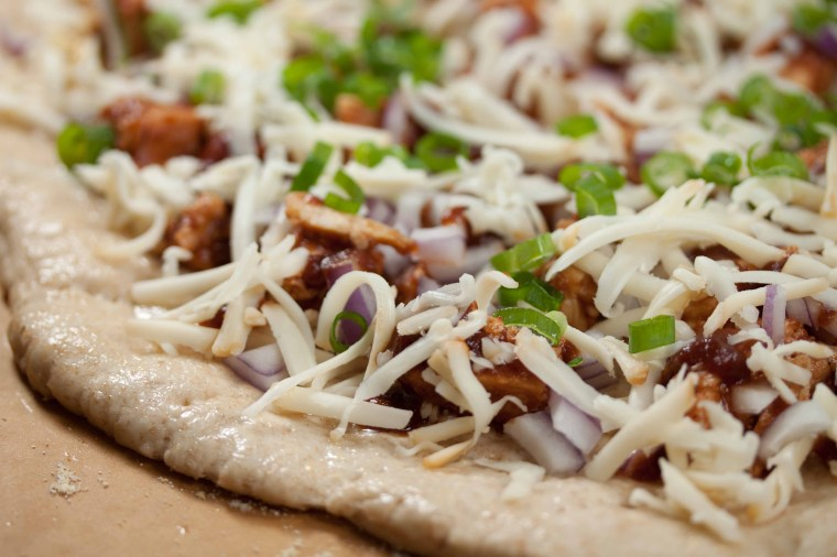 bbq chicken pizza ready to go in the oven