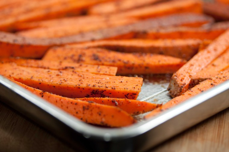 sweet potato fries going in the oven