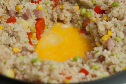 frying egg in middle of fried rice