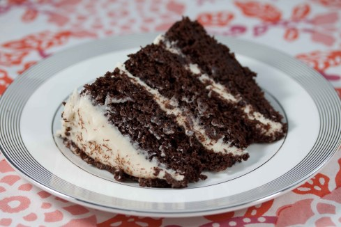 slice of chocolate cake with white chocolate cream cheese